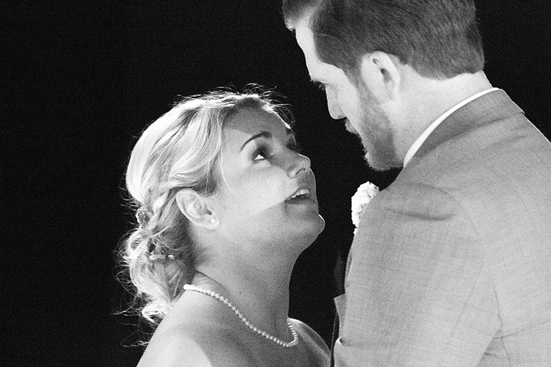 bride looks into her husband's eyes