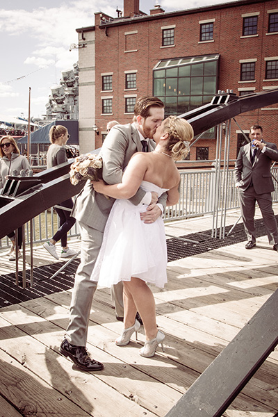 bride groom kiss on a bridge
