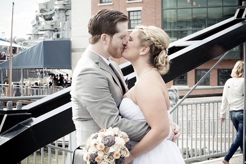 bride groom kissing at channel side in buffalo