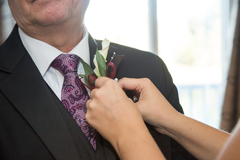 corsage pinned on the best man