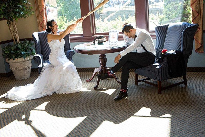 bride hits groom with a baseball bat