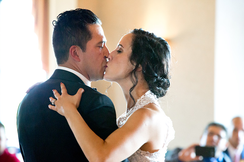 bride and groom kiss while they dance