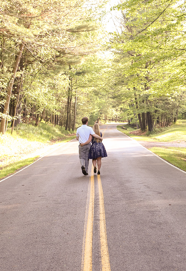 couple walking down the middle of the road