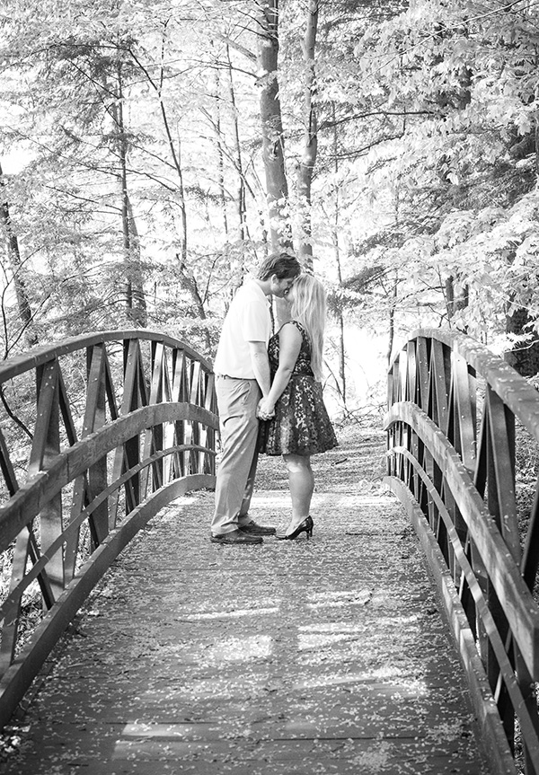 wedding engagement kiss on a bridge