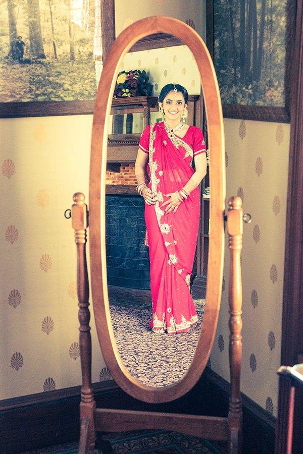 Hindu bride in a mirror