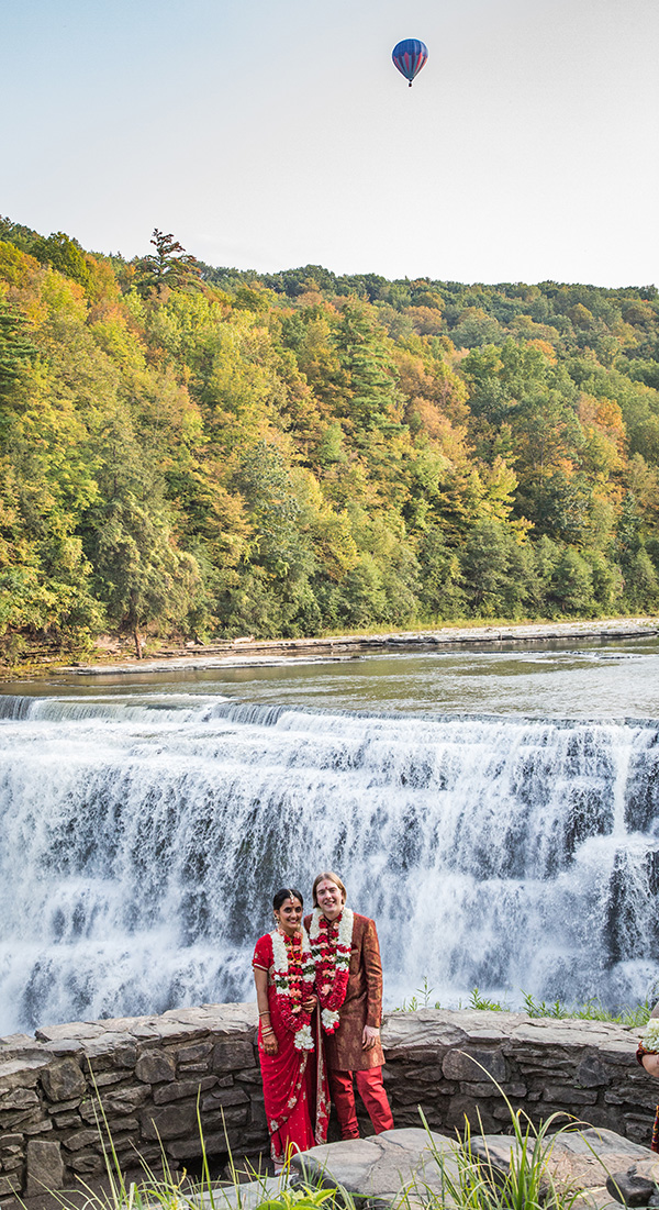 Bride and groom by a waterfall