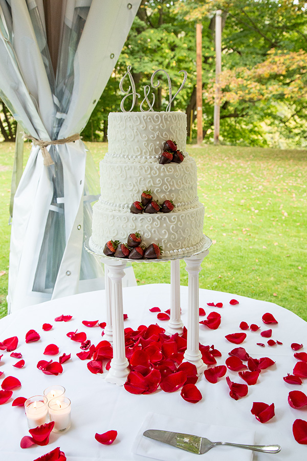 Wedding cake surrounded by rose pedals